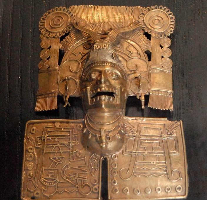 one of the most famous of the treasures found in Tomb seven at Monte Alban Oaxaca is this finely worked gold pendant in the Mixtec style. Santo Domingo museum Oaxaca