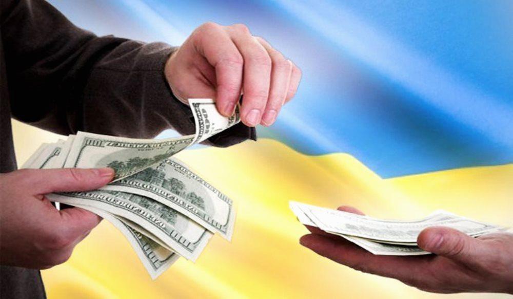 Украинские политики делят шкуру неподписанной валюты